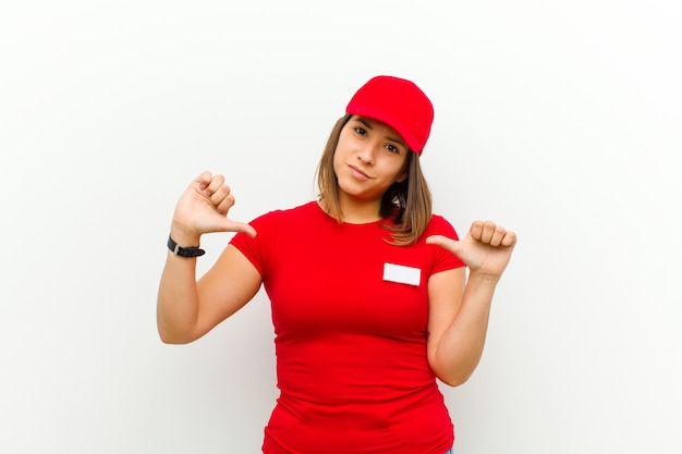 Delivery woman looking sad, disappointed or angry, showing thumbs down in disagreement, feeling frustrated