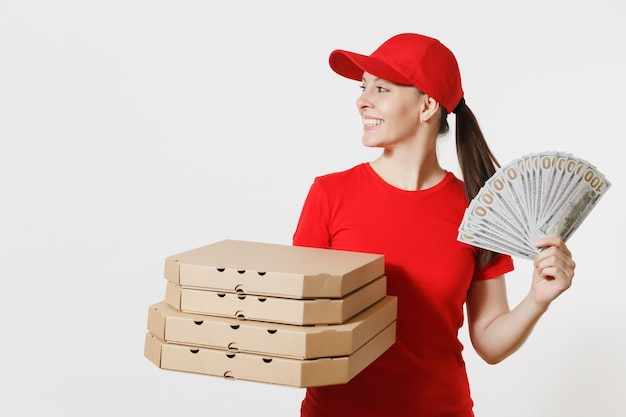 Delivery woman in red cap, t-shirt giving food order italian pizza in cardboard flatbox boxes isolated on white background. female pizzaman working as courier holding bundle of dollars, cash money.
