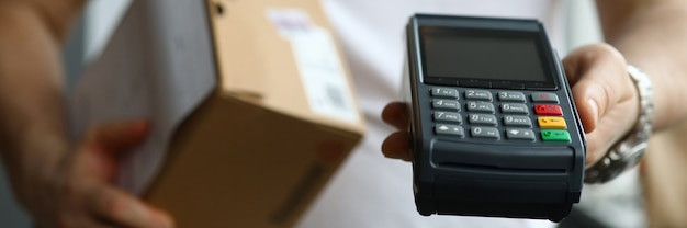 Deliveryman holding pos terminal