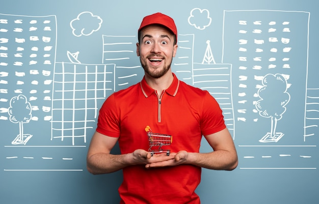 Deliveryman holds a small cart and is ready for food delivery. cyan background.