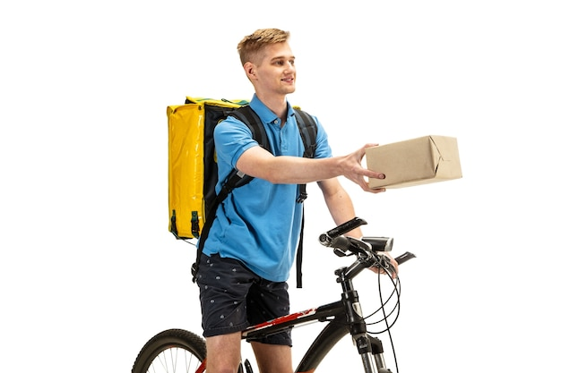 Deliveryman isolated on white studio background. contacless delivery service during quarantine. man delivers food during isolation. safety. professional occupation. copyspace for advertising.