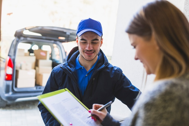 Deliveryman talking to client