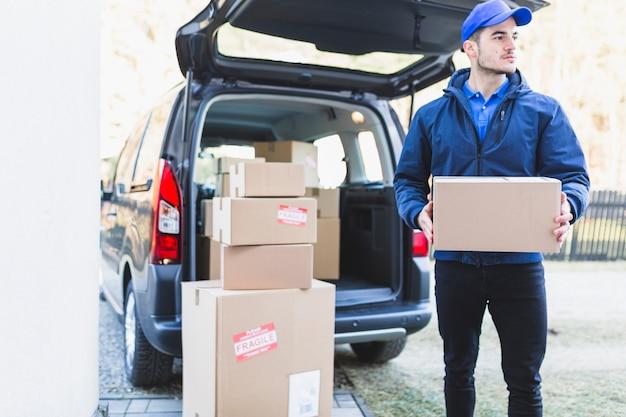 Deliveryman in uniform with box