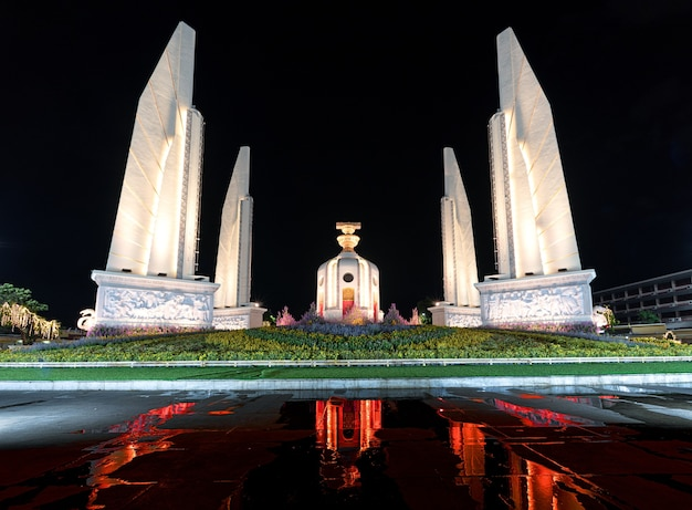 Democracy monument at night and red light