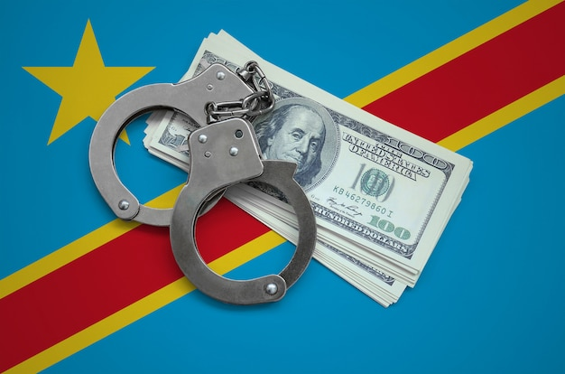 Democratic republic of the congo flag  with handcuffs and a bundle of dollars. currency corruption in the country. financial crimes