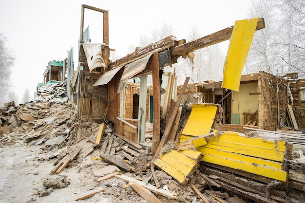 The demolition of the old dilapidated housing.