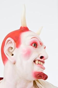 Demon face on white, close detail, focus on eyes