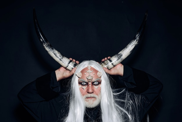 Demon with bloody horns on head devil horns devil horror concept wizard demon man with dragon skin a...