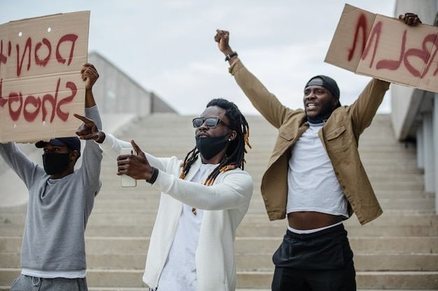 Demonstrators hold banners with the motto of the black civil rights movement