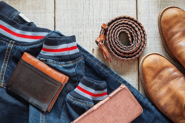 Denim and accessories on wooden.