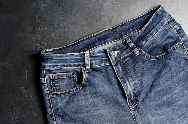 Denim. blue jeans on black . close up