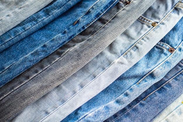 Джинсовые синие джинсы стек текстуры фона крупным планом