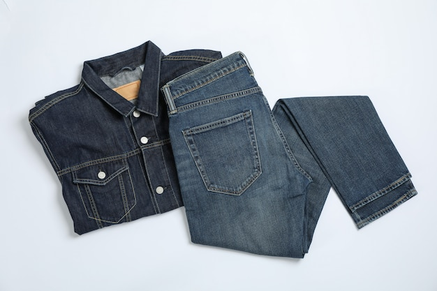 Denim jacket and pants on white table