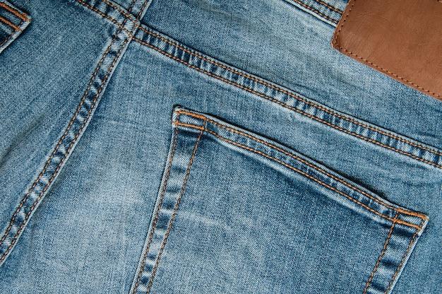Джинсовые брюки фон