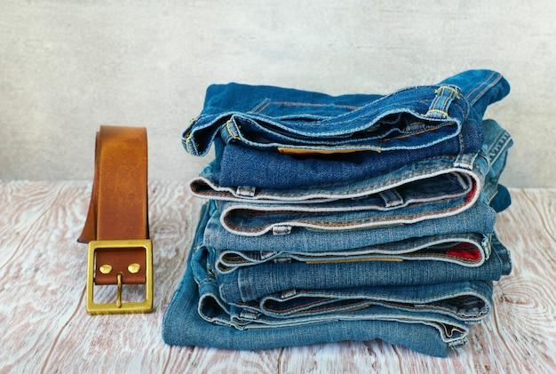 Denim pants stack on wood shelf