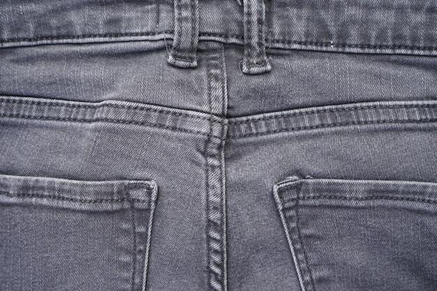 Denim pattern, gray jeans  . classic jeans texture.