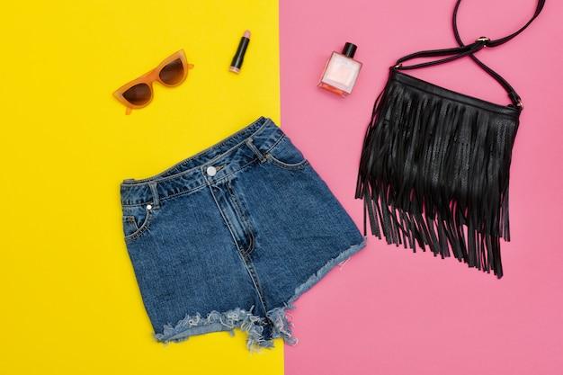 Denim shorts, black handbag, sunglasses