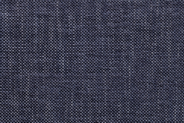 Denim textile with checkered pattern, closeup. structure of the fabric macro.