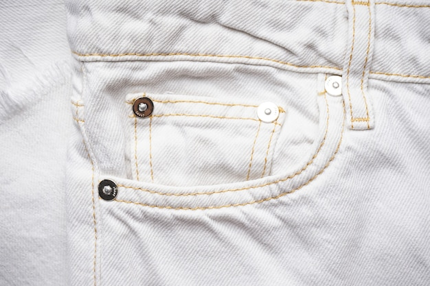 Denim texture of white jeans  , classic jeans. white jeans front pocket.