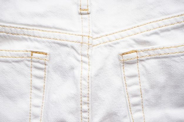 Denim texture of white jeans  , classic jeans. white jeans rear pocket.
