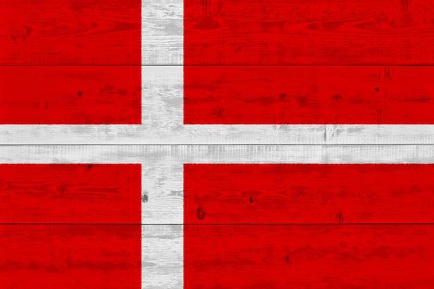 Denmark flag painted on old wood plank