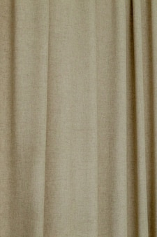 Dense textile curtain background or texture with folds.