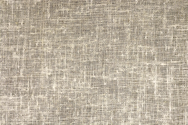 The dense texture of the old burlap, a fabric made of flax