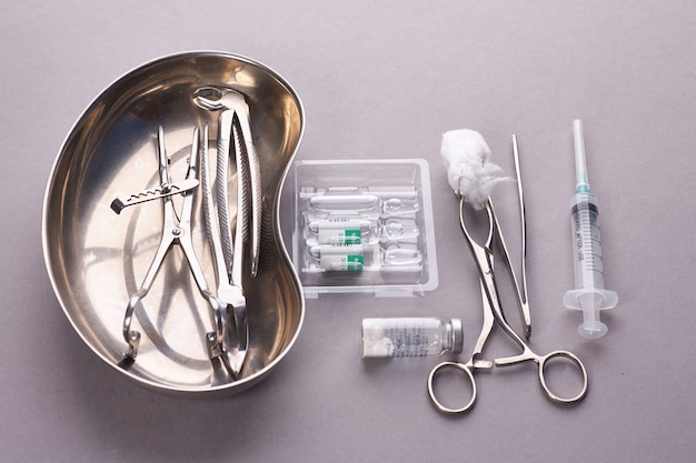 Dental appliances in sterile packaging on grey background..
