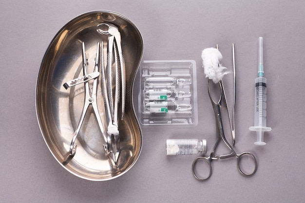 Dental appliances in sterile packaging on grey table..