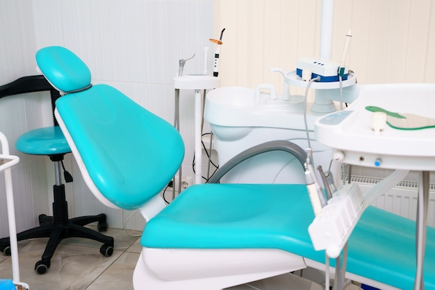 Dental chair is located in the dentist's office