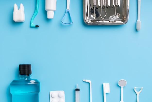 Dental elements frame on blue