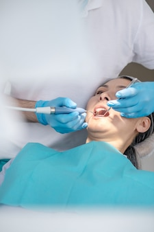 Dental filling. dentist working on patients teeth restoration and making dental filling