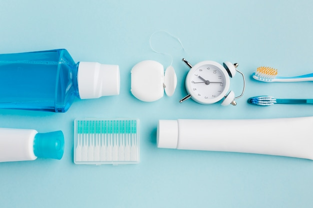 Dental hygiene products in flat lay