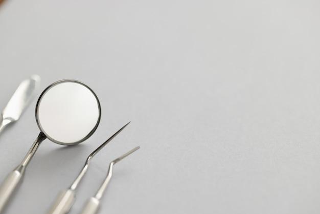 Dental instruments for work lie on table concept