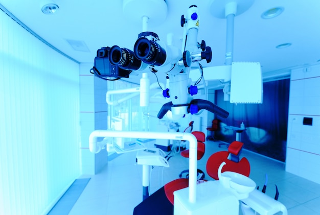 Dental microscope close-up against dental clinic background