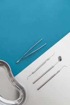 Dental tools on a blue background