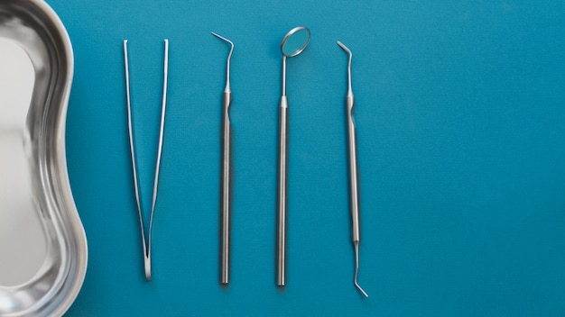 Dental tools on blue background