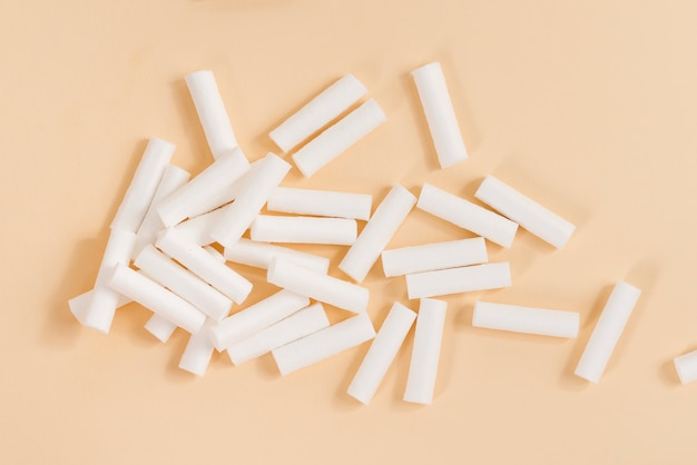 Dental white sterile dental swabs on beige background.