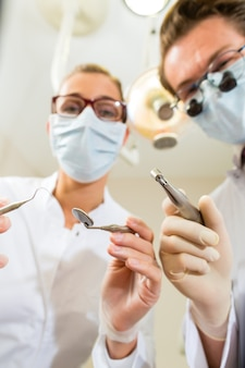 Dentist and assistant at a treatment, from the perspective of a patient