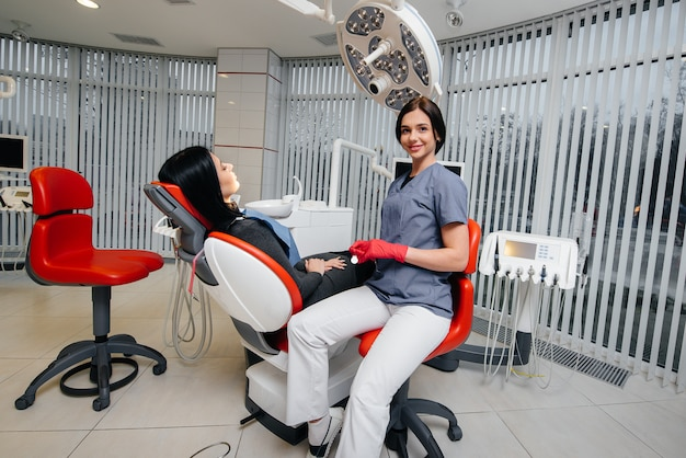 The dentist conducts an examination and consultation of the patient. dentistry