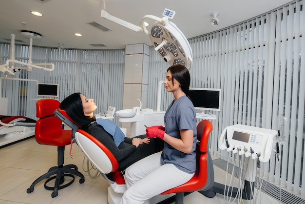 The dentist conducts an examination and consultation of the patient. dentistry.