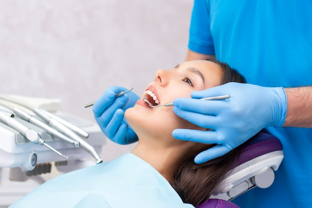 Dentist examines the patients teeth at the dentist. close up