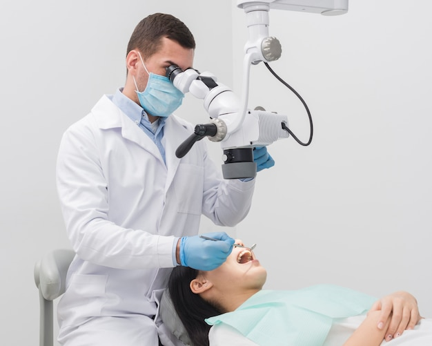Dentist examining woman