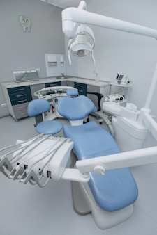Dentist interior and workplace. dental clinic. different dental instruments and tools in a dentists clinic