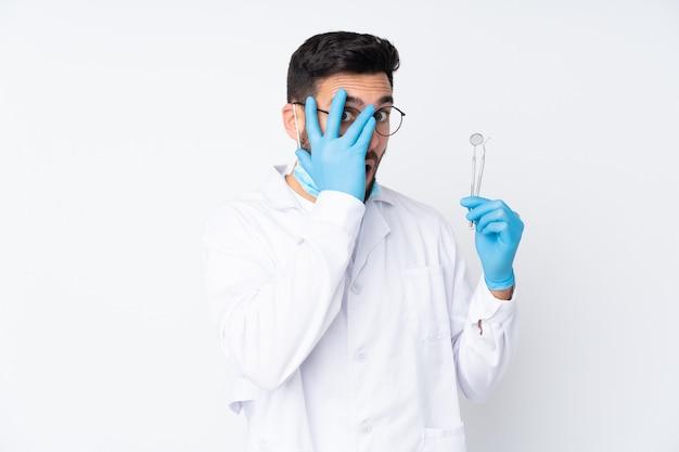 Dentist man holding tools