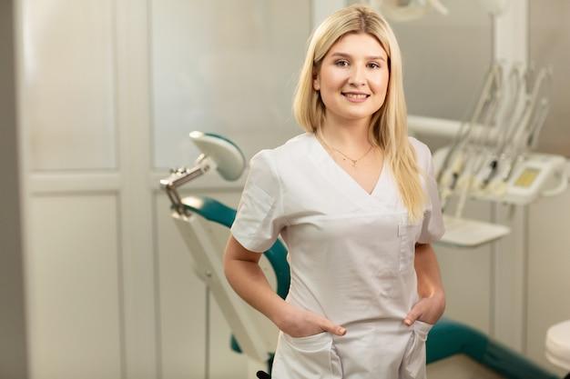 Dentist office. a doctor inside of a dentist cabinet full of medical equipment