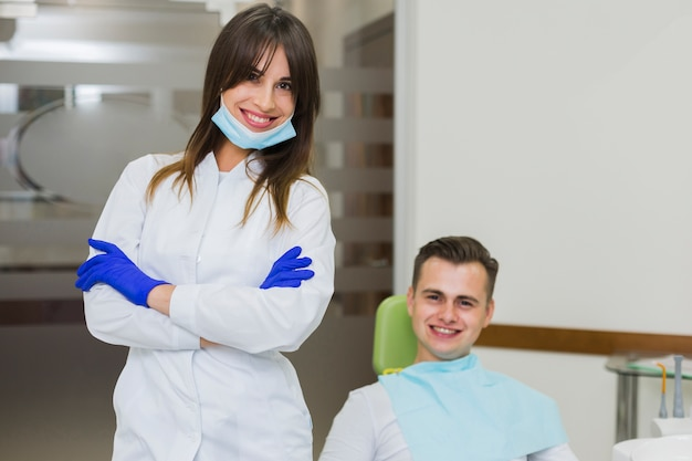 Dentist posing and smiling with patient