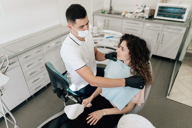 Dentist preparing patient in the office