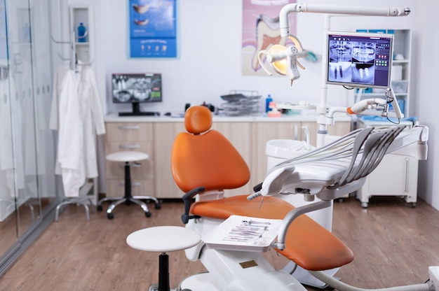 Dentist's office interior with modern chair and special dentisd equipment. the interior of stomatology clinic.