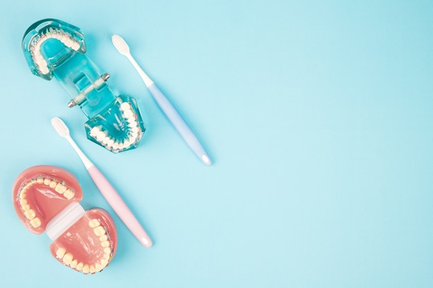 Dentist tools and orthodontic on the  blue background, flat lay, top view.